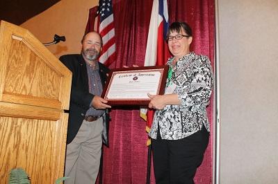 Banquet 2016 - Certificate of Appreciation, Vice Pres. Bill Titus presented to Exec. Dir. Mollie Clakley
