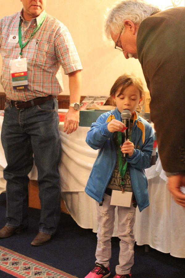 58-Youngest attendee helping with door prizes