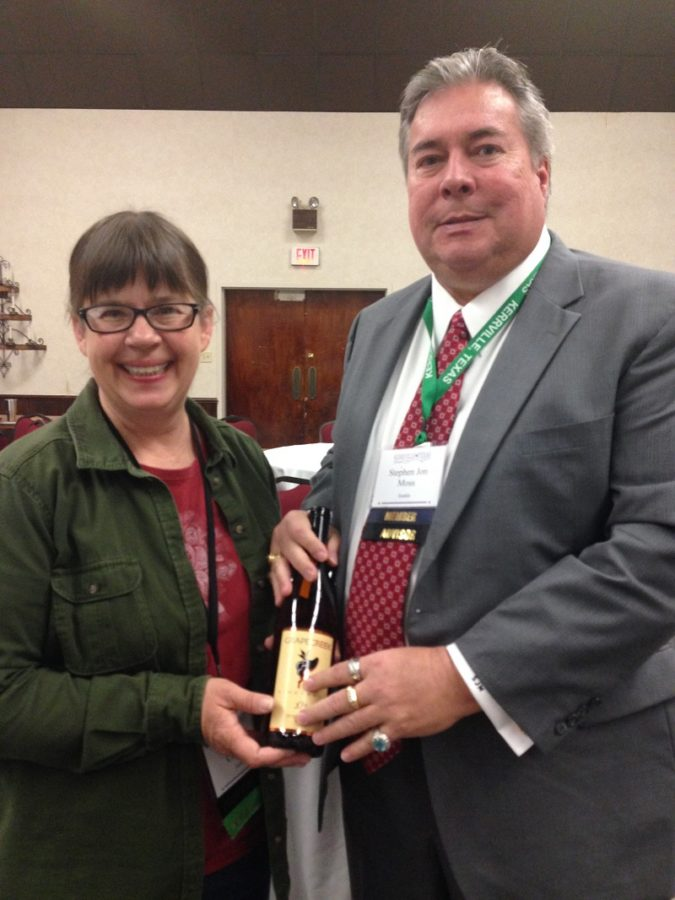 59-TCHA General Counsel Stephen Moss presenting Executive Director Mollie Clakley with a Thank You gift